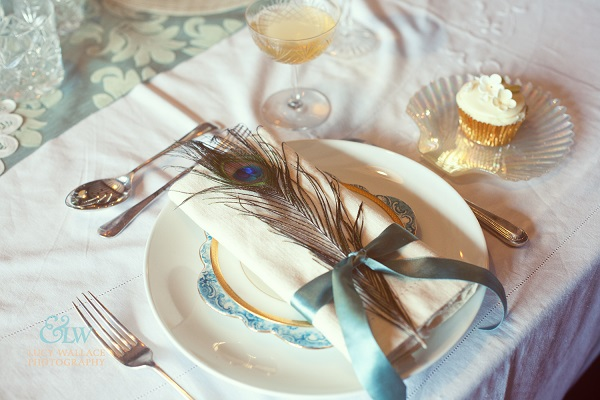 Arts and crafts wedding theme table setting peacock feather