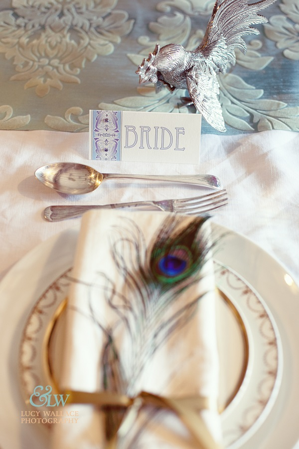 Arts and crafts wedding theme table setting peacock feather vintage